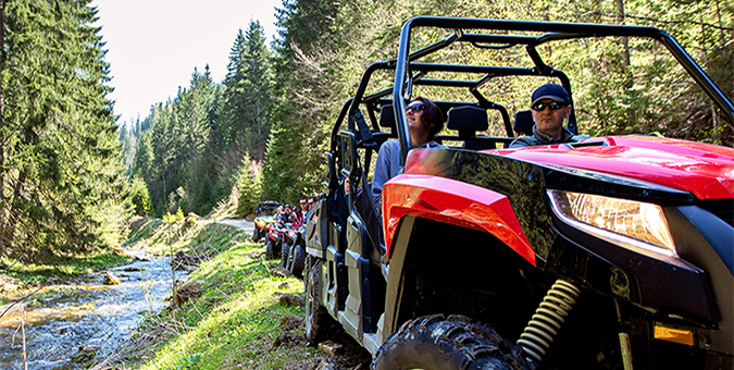 Family fun in a RZR UTV. Get prequalified online with SMB today for the ride you want.